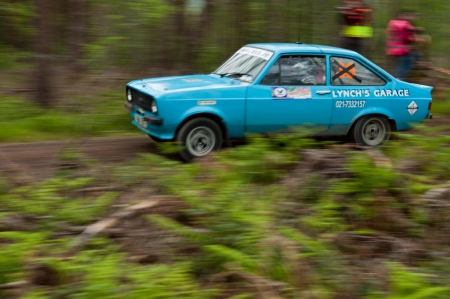 MALLOW, IRELAND - MAY 19: L. Lynch driving Ford Escort at the Jim Walsh Cork Forest Rally on May 19, 2012 in Mallow, Ireland. 4th round of the Valvoline National Forest Rally Championship.