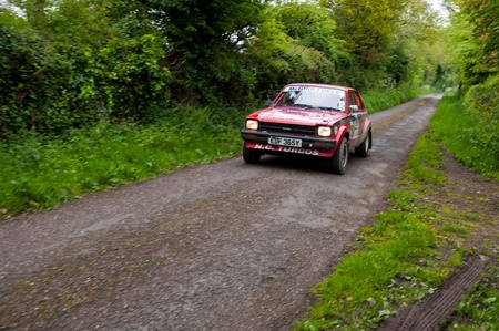 19's: MALLOW, IRELAND - MAY 19: S. Mcgirr driving Toyota Starlet at the Jim Walsh Cork Forest Rally on May 19, 2012 in Mallow, Ireland. 4th round of the Valvoline National Forest Rally Championship. Editorial