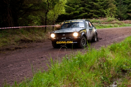 MALLOW, IRELAND - MAY 19: M. Conlon driving Ford Escort at the Jim Walsh Cork Forest Rally on May 19, 2012 in Mallow, Ireland. 4th round of the Valvoline National Forest Rally Championship. Stock Photo - 13760796