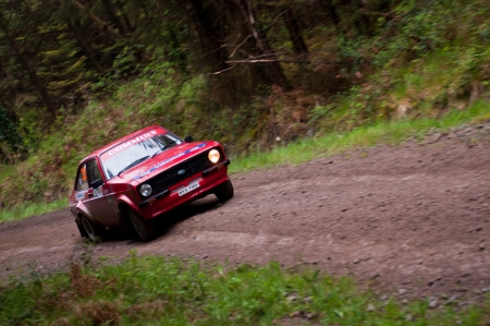 MALLOW, IRELAND - MAY 19: A. Commins driving Ford Escort at the Jim Walsh Cork Forest Rally on May 19, 2012 in Mallow, Ireland. 4th round of the Valvoline National Forest Rally Championship. Stock Photo - 13760729