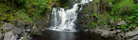 torrent: stunning Torc waterfall in the Killarney National Park, Ireland (panoramic picture with 180 angle view) Stock Photo