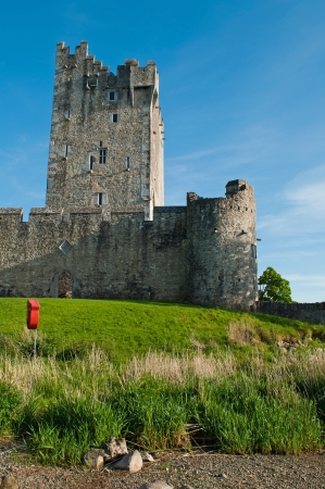 ie: stunning Ross Castle in Killarney (County Kerry), Ireland (blue sky background)