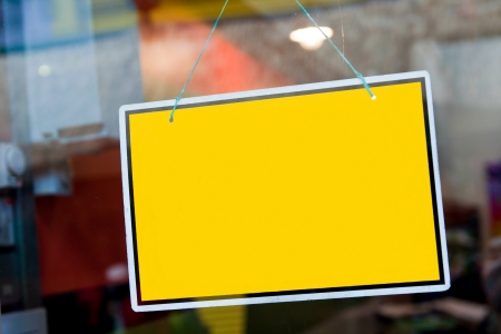 welcome door: gorgeous yellow sign hanging on a window door outside a restaurant, store, office or other (copy-space available for design) Stock Photo