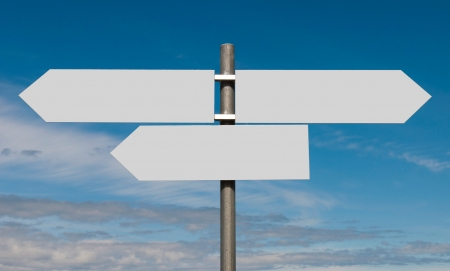multidirectional: empty multidirectional sign against a blue sky background (boards isolated on grey) Stock Photo