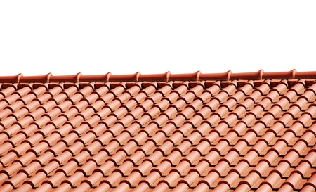 orange tiles on the roof of a house  isolated on white background Stock Photo - 14076163