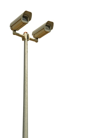 two video surveillance cameras on a pole (isolated on white background) Stock Photo - 14173648