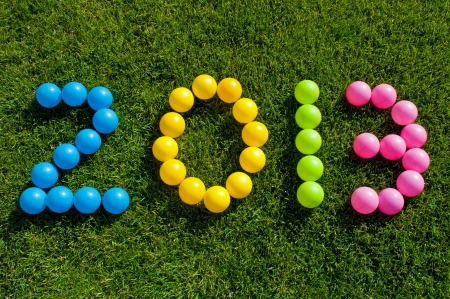 Happy New Year 2013 against a green grass background Stock Photo - 14851218