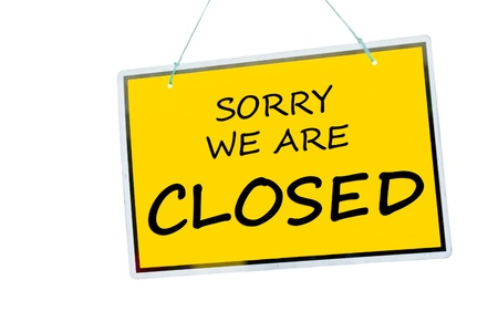 sorry we are closed sign hanging isolated on a white background photo