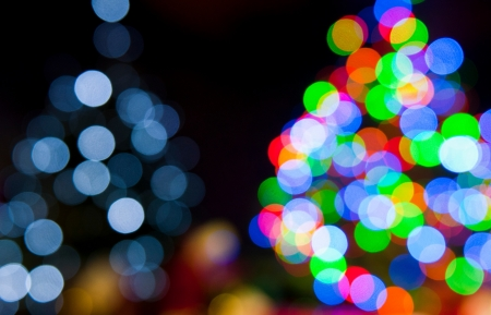 two blurred christmas tree lights on a black background Stock Photo - 16411944