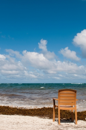 singular: singular chair at the beach in Vieux Fort, Saint Lucia (conceptual picture for vacations or retirement)