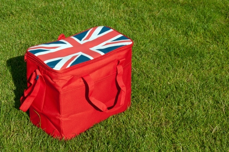 red lunch bag with the union flag  United Kingdom  on the grass field  copy-space available  photo