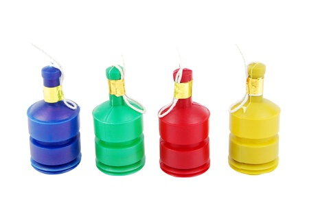 poppers: colorful row of party poppers (isolated on white background)