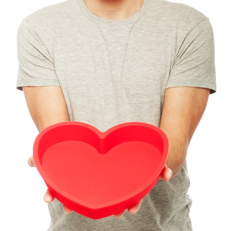 man holding a red heart (isolated on white background) photo