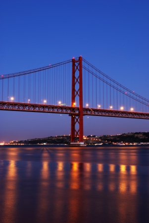 lisbonne: stunning night shoot of old Salazar bridge also known as April 25th in Lisbon, Portugal