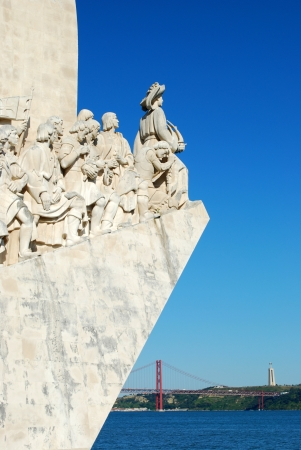 discoveries: famous monument to the maritime discoveries in Lisbon, Portugal (April 25th bridge on the background) Editorial