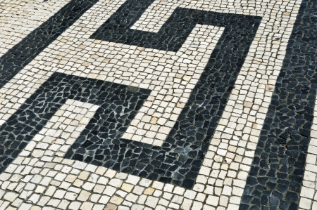 portuguese typical pavement known as calcada or cobblestone hand-made photo
