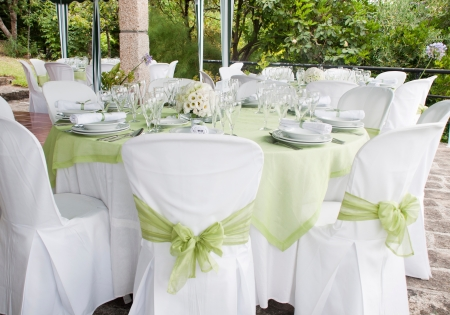 outdoor event: gorgeous wedding chair and table setting for fine dining at outdoors Stock Photo