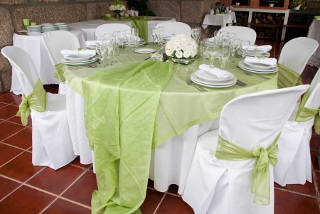 wedding table setting: gorgeous wedding chair and table setting for fine dining at outdoors Stock Photo