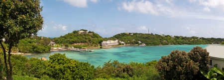 antigua: panoramic picture of Antigua Long Bay, gorgeous view surrounded by tropical nature and some typical houses