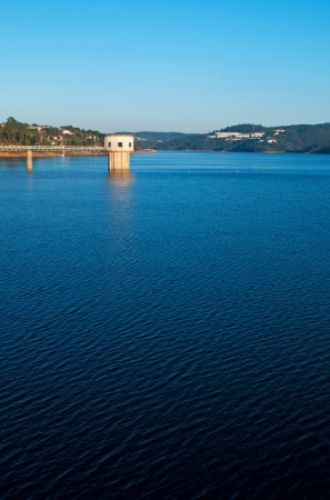 bode: stunning view of river Zezere and Castelo de Bode Dam in Tomar, Portugal (gorgeous blue sky) Stock Photo