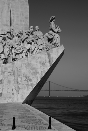 discoveries: black and white picture of the famous monument to the maritime discoveries in Lisbon, Portugal (April 25th bridge on the background) Editorial