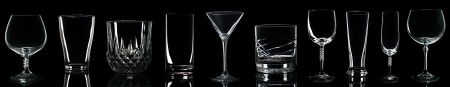gorgeous collection of drink glasses isolated on black background photo
