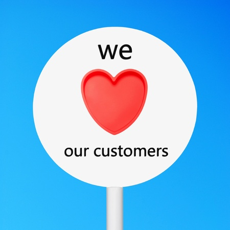 our: conceptual picture regarding business customer care saying we love our customers (against a blue sky background) Stock Photo
