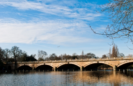 Serpentine bridge and lake in Hyde Park in London, England photo