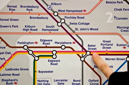 finger pointing to Baker Street Underground station in London, United Kingdom  direction for Madame Tussauds