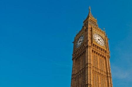 famous Big Ben in Westminster, London  against a vibrant blue sky, plenty copy-space  photo