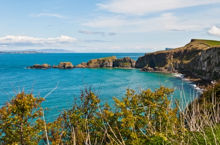 stunning seashore view to Carrick-a-Rede Rope Bridge in Northern Ireland photo