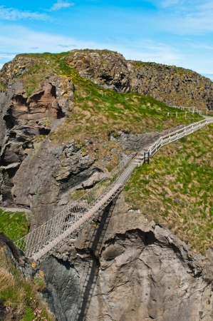 stunning Carrick-a-Rede Rope Bridge in Northern Ireland, UK photo