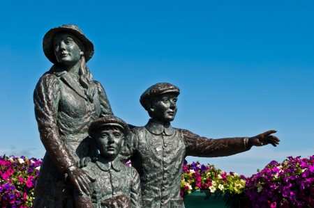 annie: The Annie Moore Memorial, statue of Annie Moore and her two Brothers in Cobh, Ireland  Annie was the first immigrant to the United States to pass through the Ellis Island facility in New York Harbor