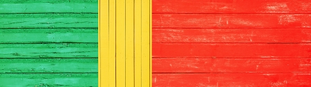 conceptual portuguese flag made of wooden planks  green, yellow and red  photo