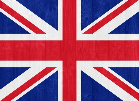 gorgeous United Kingdom flag painted on a wood plank texture photo