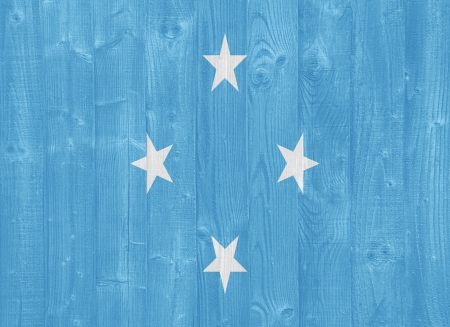 micronesia: gorgeous Micronesia flag painted on a wood plank texture Stock Photo