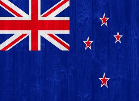 bandera de nueva zelanda: hermosa bandera de Nueva Zelanda pintado sobre una textura de madera del tablón