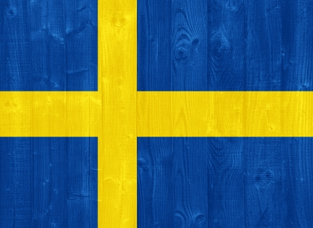 sweden flag: gorgeous Sweden flag painted on a wood plank texture Stock Photo
