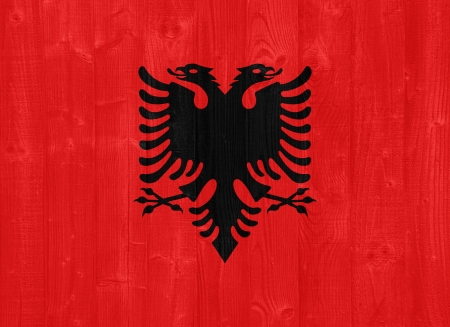albanian: gorgeous Albania flag painted on a wood plank texture Stock Photo