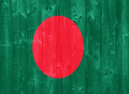 gorgeous Bangladesh flag painted on a wood plank texture photo