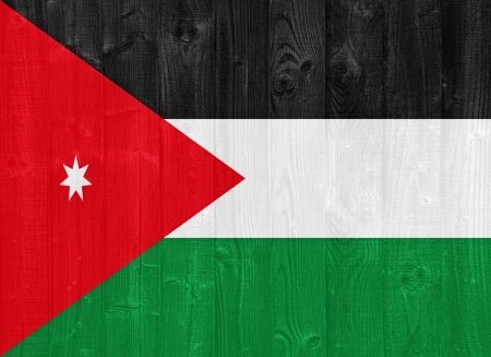 the hashemite kingdom of jordan: gorgeous Jordan flag painted on a wood plank texture