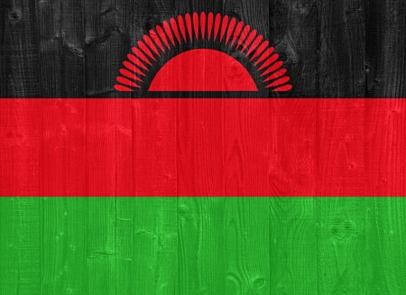 malawi flag: gorgeous Malawi flag painted on a wood plank texture