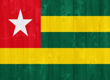 gorgeous Togo flag painted on a wood plank texture photo