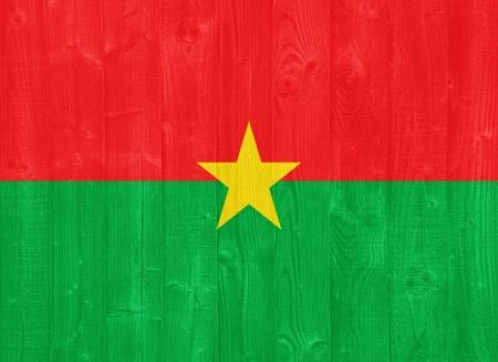 burkina faso: gorgeous Burkina Faso flag painted on a wood plank texture