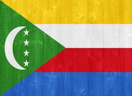 comoros: gorgeous Comoros flag painted on a wood plank texture Stock Photo