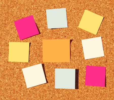 colorful reminder notes on a corkboard photo
