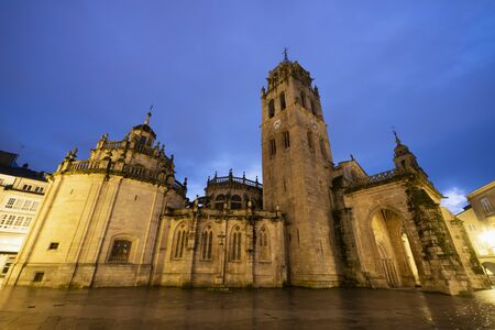 Lugo Cathedral, Romanesque, 13th century. Nice night view lit by streetlights and full of colorful