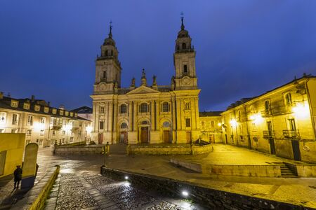 Lugo Cathedral, Romanesque, 13th century. Nice night view lit by streetlights and full of colorful Banco de Imagens - 134845374
