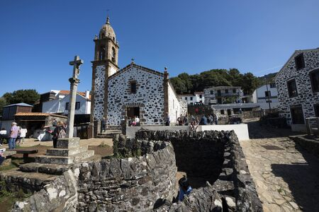 SAN ANDRES DE TEIXIDO, SPAIN - SEPTEMBER 28, 2019: Church of San Andres de Teixido on a sunny day in late summer. Religious sanctuary deeply rooted in the area Editorial