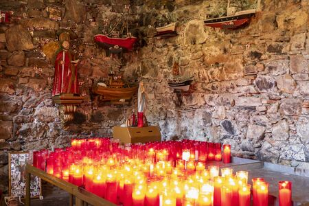 SAN ANDRES DE TEIXIDO, SPAIN - SEPTEMBER 28, 2019: Cave of San Andres in the village of San Andres de Teixido. Religious sanctuary deeply rooted in the area